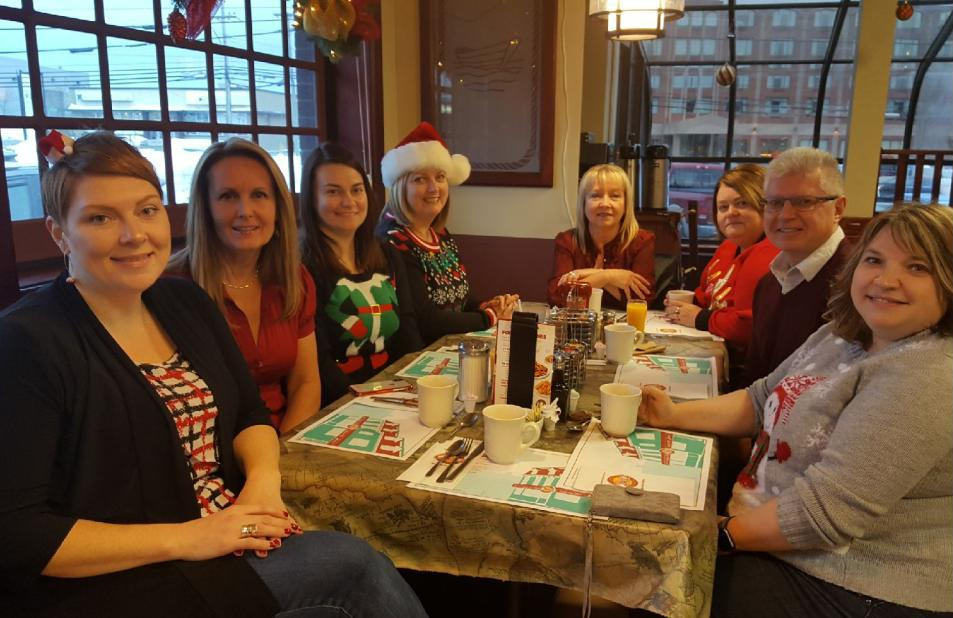 Some of the PSCU staff celebrate the beginning of the Christmas break; breakfast at Ches's, yummy!