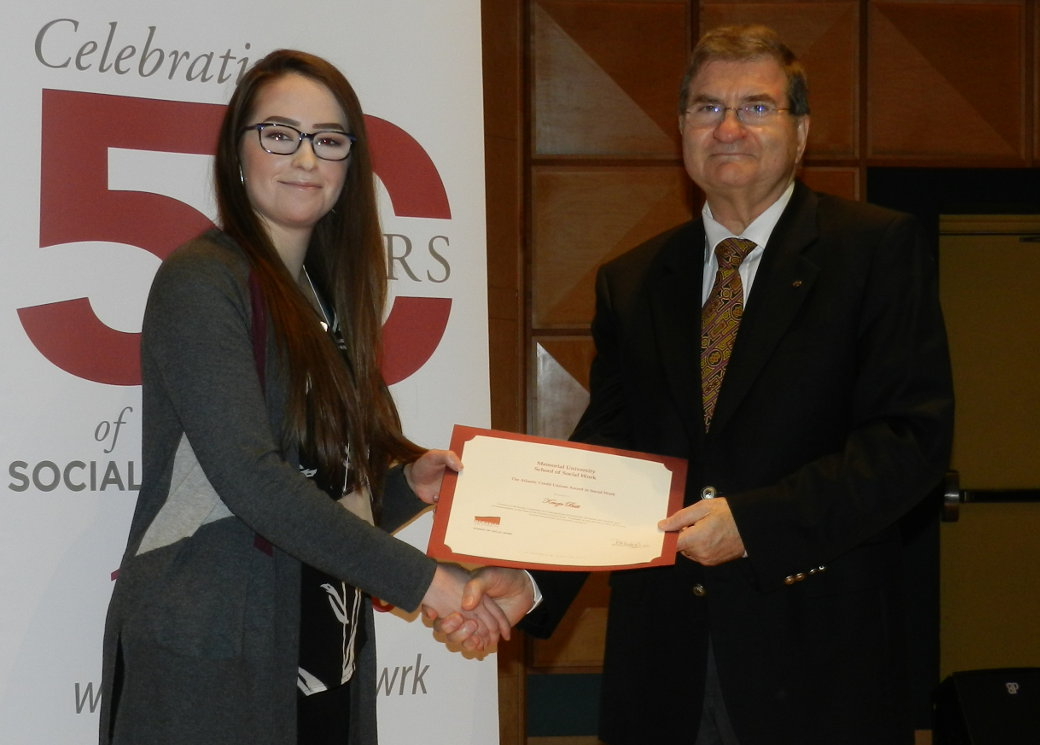 Chair of Public Service Credit Union Doug Dewling, representing Atlantic Central presents Kenzie Butt the Atlantic Central Award in Social Work at the School of Social Work Memorial University May 30, 2018.