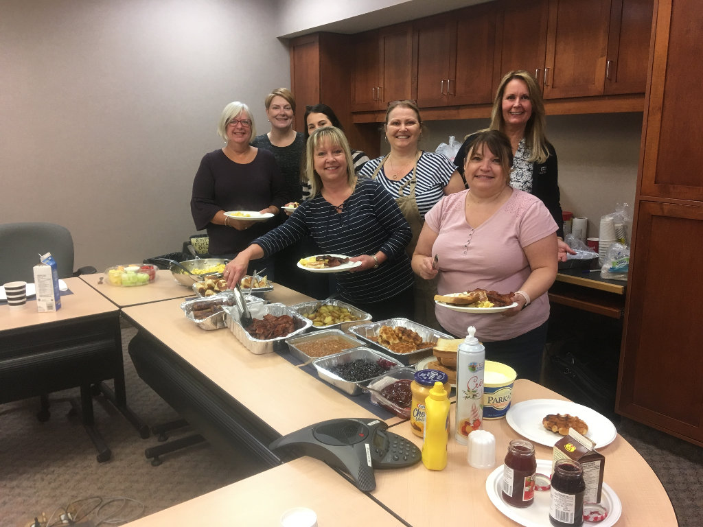 PSCU employees celebrating the last day of CU week with a hardy not so healthy breakfast!