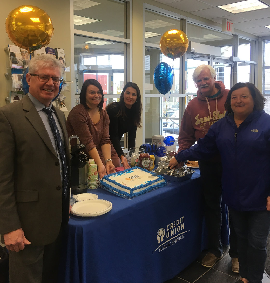 Members Ray Franey and Margaret Potts along with employees Nichole Manning, Renee Alexander, and Brian Quilty cutting the cake to celebrate International Credit Union Day October 18.